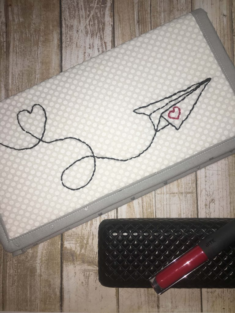 airplane hand embroidery wristlet