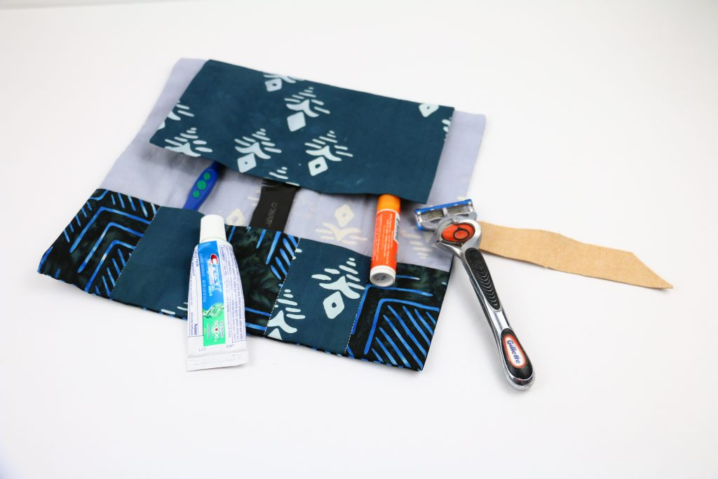 on the go toiletries roll up, gifts for guys, sewing gifts for men, gifts for him, easy sewing toiletry roll up, diy toiletries roll up, diy travel toiletry roll